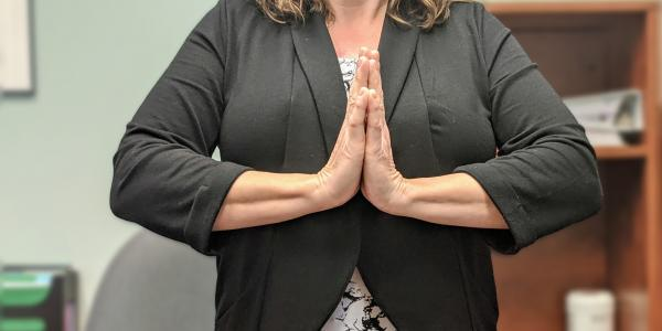 Woman doing Namaste sign