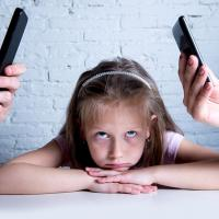 Distracted parents neglecting child