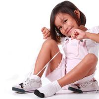 Girl Tying shoe